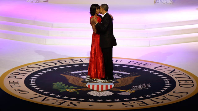 PHOTO: President Barack Obama and first lady Michelle Obama kiss as they dance during the Commander-In-Chief inaugural ball at the Washington Convention Center during the 57th Presidential Inauguration on Monday, Jan. 21, 2013 in Washington.