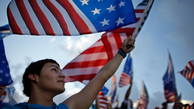 PHOTO: A pro-statehood New Progressive Party supporter waves the U.S. flag during the party's closing campaign rally in San Juan, Puerto Rico, Saturday, Nov. 3, 2012.