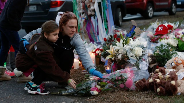 PHOTO:  Mourners gather for a candlelight vigil at Ram's Pasture to remember shooting victims, Saturday, Dec. 15, 2012 in Newtown, Conn.
