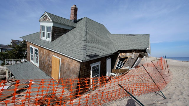 PHOTO: A beach front home that was severely damaged two months ago by Superstorm Sandy rests in the sand in Bay Head, N.J., Thursday, Jan. 3, 2013.