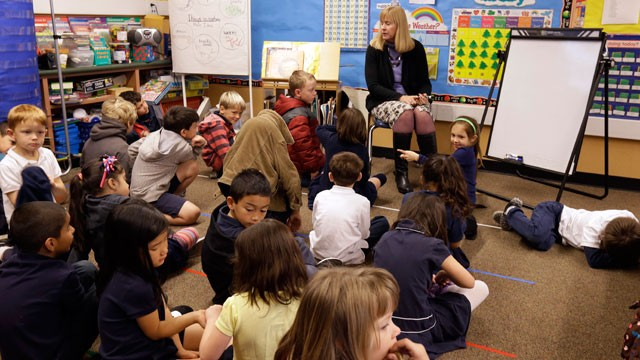 PHOTO: In this Jan. 24, 2013 file photo, first grade teacher Lynda Jensen teaches her class of 30 children at the Willow Glen Elementary School in San Jose, Calif. Looming federal spending cuts are expected to dampen California's economic recovery.