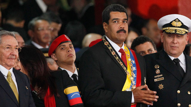 PHOTO:  Venezuelas newly sworn-in President Nicolas Maduro, second from right, attends a military parade.