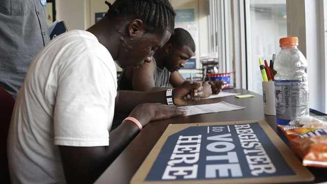 PHOTO:&nbsp;Blake West, 20, left, and Dehjahn Swain, 19, right, register to vote at a campaign office for President Barack Obama, Monday, Oct. 8, 2012 in Miami. Tuesday is the last day to register to vote in the general election Nov. 6.