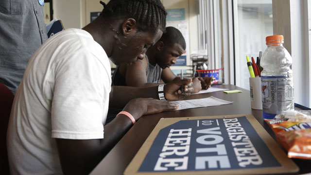 PHOTO:Blake West, 20, left, and Dehjahn Swain, 19, right, register to vote at a campaign office for President Barack Obama, Monday, Oct. 8, 2012 in Miami. Tuesday is the last day to register to vote in the general election Nov. 6.