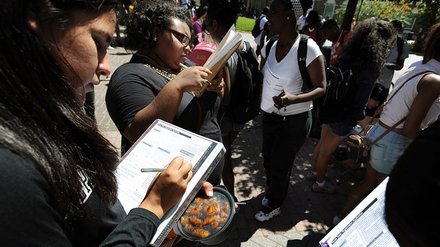 First-time voters Victoria Pena, 18, left, and Nijah Lastrapes, 19, fill out voter registration forms during a campus registration event Tuesday, Sept. 11, 2012, at Stephen F. Austin State University in Nacogdoches, Texas.