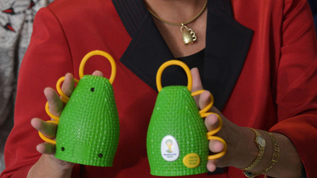 PHOTO: Brazils President Dilma Rousseff holds caxirolas during their official presentation at the Planalto Palace.