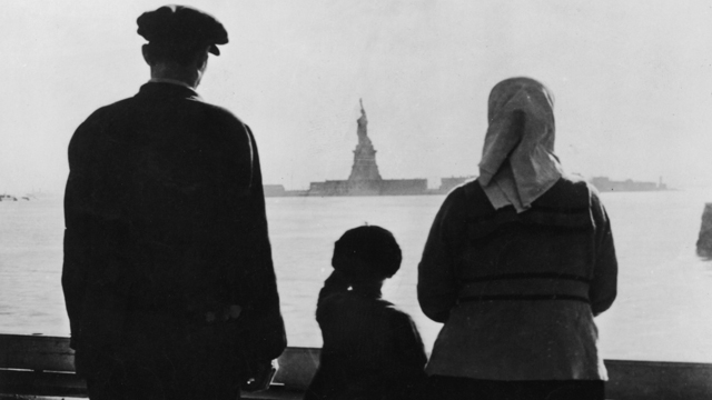 PHOTO:An immigrant family on Ellis Island looking across New York Harbor at the Statue of Liberty.