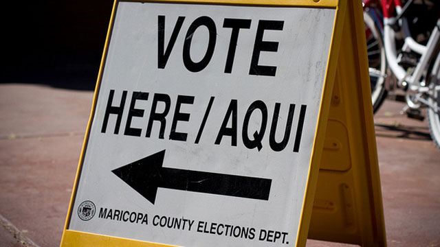 PHOTO:A sign points voters in the direction of a polling plac