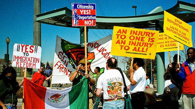 PHOTO:Pro-immigrant demonstrators hold signs at an immigration reform rally in Denver, Colorado in March 2010.