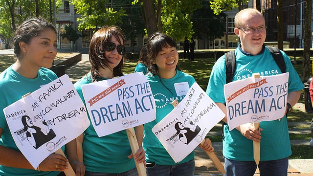 PHOTO:&nbsp;Young people hold signs in support of the DREAM Act.