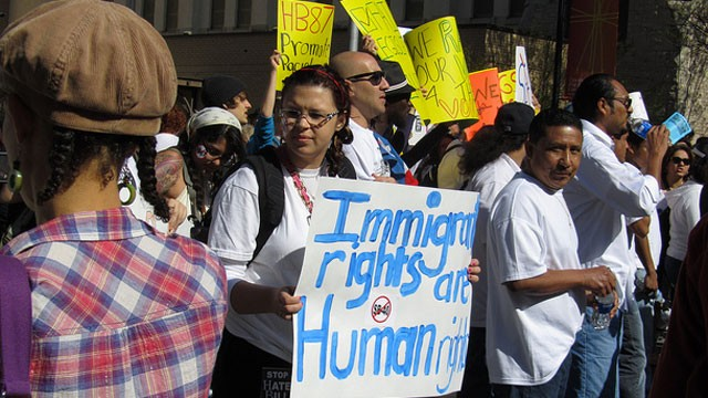 PHOTO: Immigration activists protest Georgia's immigration law at a rally in 2011.