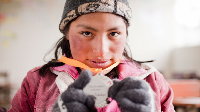 PHOTO: Senna holds her poetry medal in La Rinconada, Peru. She is one of nine girls featured in the documentary Girl Rising.