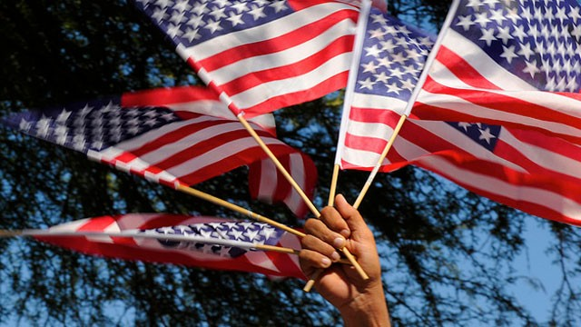PHOTO:&nbsp;American flags are waved at a rally for immigration reform in Phoenix, Arizona in 2010. A bipartisan group of senators announced a framework for immigration reform in Washington, DC, in January 2013.