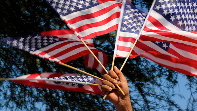 PHOTO:American flags are waved at a rally for immigration reform in Phoenix, Arizona in 2010. A bipartisan group of senators announced a framework for immigration reform in Washington, DC, in January 2013.