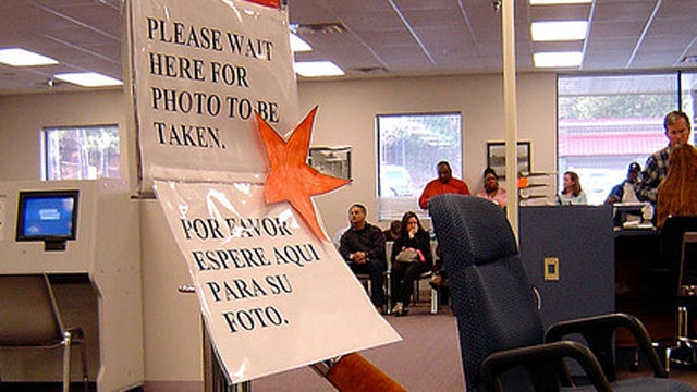 PHOTO: A sign tells people at a Division of Motor Vehicles office where to stand.