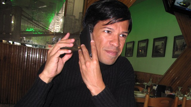 PHOTO:&nbsp;Gay rights activist Pedro Julio Serrano eats lunch in his neighborhood in Queens, New York, while conducting a radio interview with a media outlet in Puerto Rico.