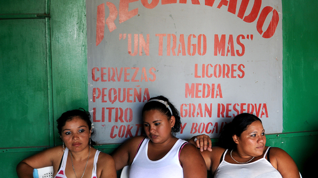 PHOTO: Nicaraguan sex workers and Yajaira, Alejandra, and Jessica wait for clients at a brothel in Managua. Sex trafficking in Latin America generates an estimated $16 billion in business annually.