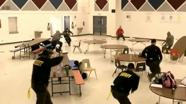 PHOTO: Members of Maricopa County Sheriff Joe Arpaio's volunteer posse participate in a simulated school shooting on Saturday, Feb. 9, 2013 near Phoenix, Arizona.
