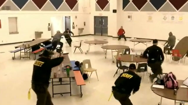 PHOTO: Members of Maricopa County Sheriff Joe Arpaios volunteer posse participate in a simulated school shooting on Saturday, Feb. 9, 2013 near Phoenix, Arizona.