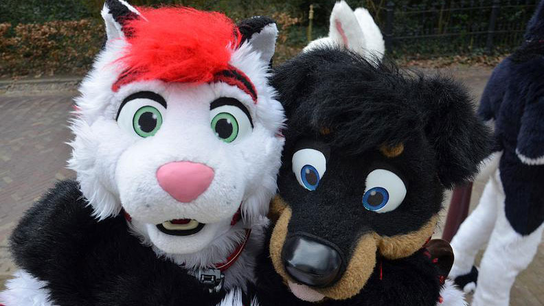 PHOTO: Two furries pose at the Furry Weekend Holland convention.