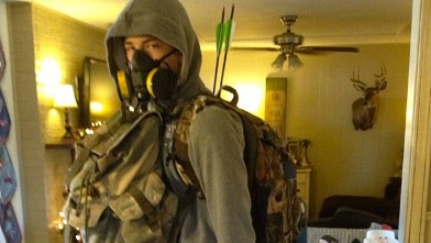 PHOTO:A young man dressed in survivalist gear, &quot;bug-out bag&quot; and all.