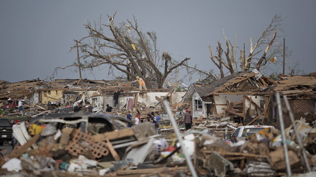 PHOTO: MOORE, OK - MAY 20: People assess the damage after a powerful tornado ripped through the area on May 20, 2013 in Moore, Oklahoma.