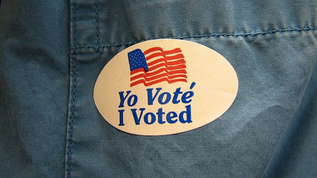 PHOTO: An ?I voted? sticker is displayed on a shirt pocket.