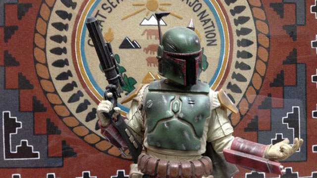 """PHOTO:""""Star Wars"""" character Boba Fett in front of the Navajo Nation seal."""