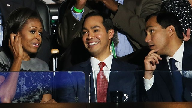 PHOTO: First Lady Michelle Obama talks with San Antonio Mayor Julián Castro (C) and his brother Joaquín Castro during day two of the Democratic National Convention on September 5, 2012.