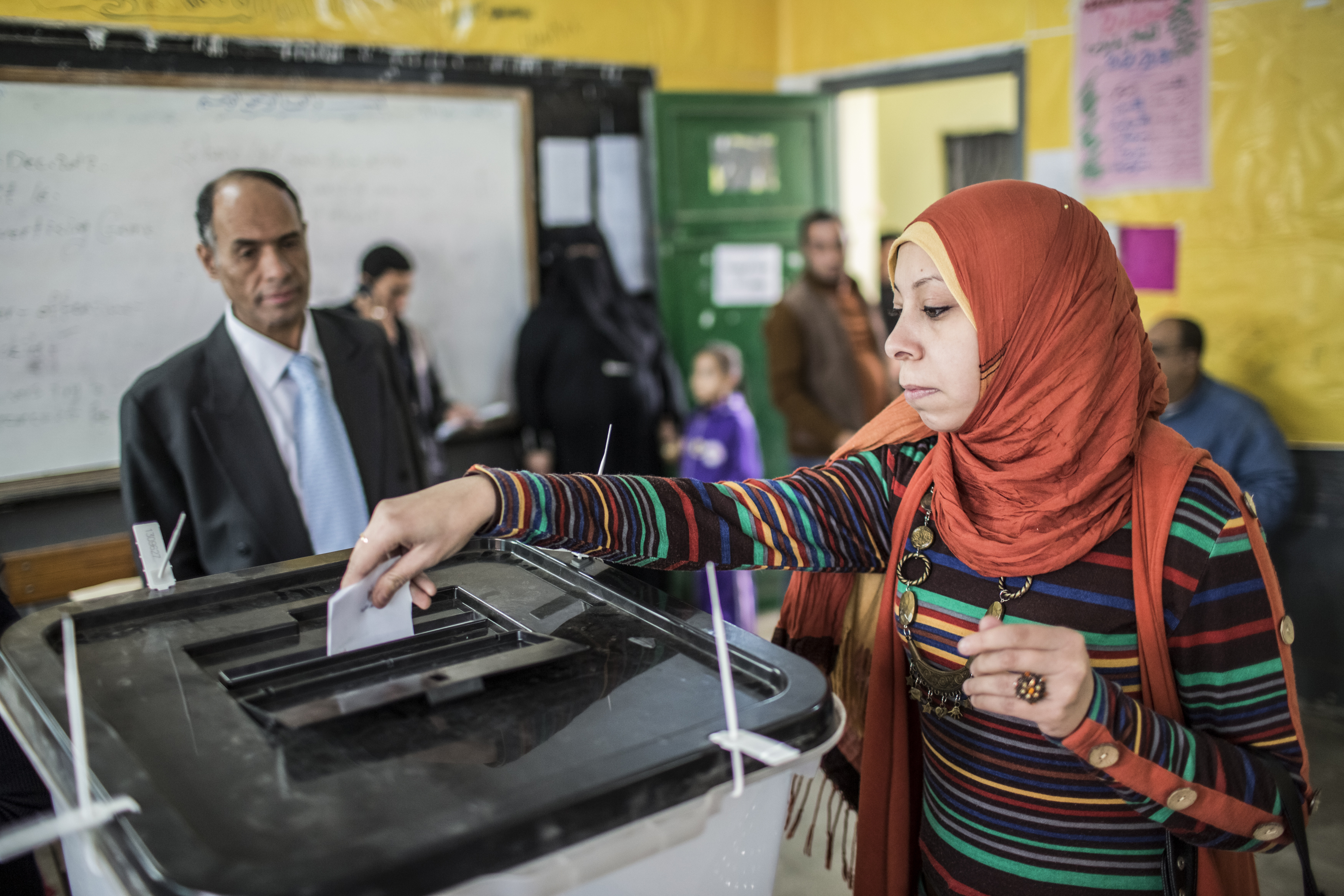 PHOTO: An Egyptian woman votes in a recent election. Women gained the right to vote in Egypt in 1956.