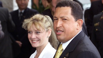 PHOTO:Hugo Chavez, the president for Venezuela, is accompanied by his then-wife Marisabel Rodriguez de Chavez, in the hotel where the inauguration XI Iberoamericana is, 23 November 2001, in Lima.