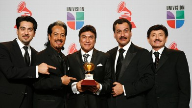 PHOTO:Los Tigres Del Norte pose with their award during the 12th annual Latin Grammy Awards at the Mandalay Bay Hotel and Casino Event Center in Las Vegas, Nevada on November 10, 2011.