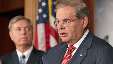 PHOTO: U.S. Senate Foreign Relations Committee Chairman Robert Menendez (D-N.J.) (R) and U.S. Sen. Lindsey Graham (R-S.C.) hold a news conference on May 22, 2013 in Washington, D.C.