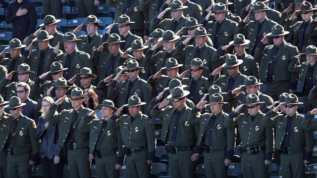 PHOTO: U.S. Border Patrol agents salute during a memorial service for slain comrade Brian Terry on January 21, 2011 in Tucson, Arizona.