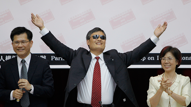 PHOTO: Chinese lawyer and human rights activist Chen Guangcheng gestures to the audience in the Legislative Yuan on June 25, 2013 in Taipei, Taiwan. Chen Guangchen currently lives in the United States, but is visiting Taiwan until July 11.