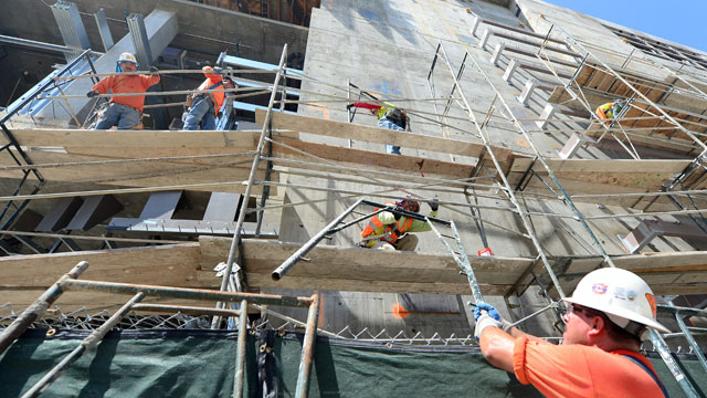 PHOTO: Construction laborers work on the construction of the Broad Museum in downtown Los Angeles on May 30, 2013.