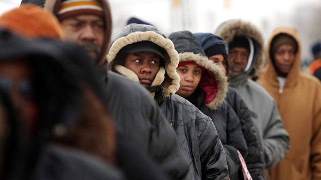 PHOTO: People wait in a several block line to receive gifts of food, personal care and household items and toys at the A Miracle in Motown event, part of a program to help working poor and disadvantaged families December 18, 2008 in Detroit, Michigan.