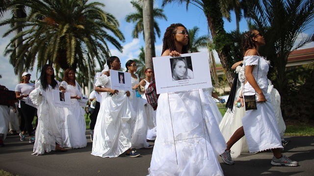 PHOTO: College students wear wedding gowns as they participate in the College Bride's Walk from Barry University on February 8, 2013 in Miami Shores, Florida. The students walked six miles to raise awareness of the issue of domestic violence.