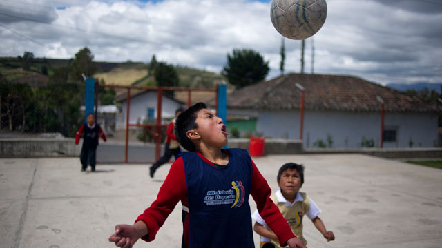 PHOTO: School children are pictured at a rural school with a significant number of Colombian refugees at La Palizada in Tulcan, Carchi province, close to the Colombian border on November 7, 2012.