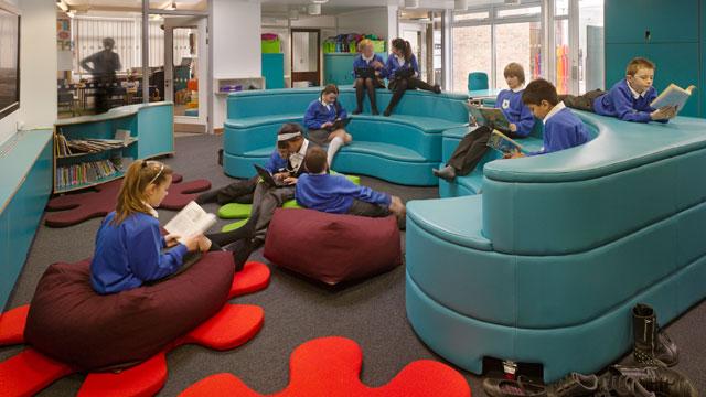 PHOTO:Children read at Towers Junior School on Windsor Road in London, Essex, United Kingdom.