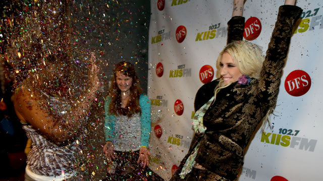 PHOTO: Ke$ha shares a (glittery) moment with fans.