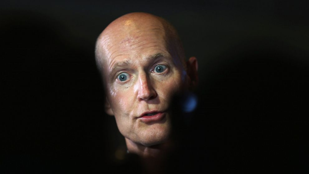PHOTO: Florida Governor Rick Scott speaks with the media after holding a Florida Cabinet at the Miami-Dade College Wolfson Campus Auditorium on August 20, 2013 in Miami, Florida.