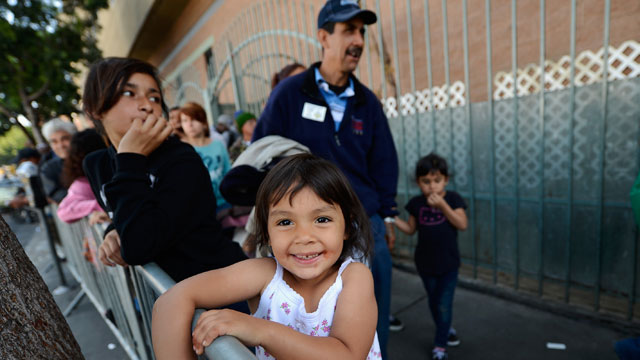 PHOTO:Destiny Barajas, 3, and her family wait in line for dinner on Good Friday during the Skid Row Easter event at the Los Angeles Mission on March 29, 2013 in Los Angeles, California. Volunteers served the homeless of Skid Row.
