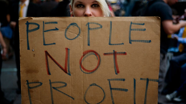 PHOTO: An Occupy Wall Street protester holds a sign during a demonstration in New York, U.S., on Monday, Sept. 17, 2012. The protest movement sparked a global revolt against economic inequality.