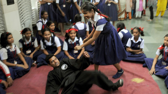 PHOTO:An Indian school girl (3R) practises self-defence with an instructor during a self-defence class at a school in Mumbai on January 4, 2013.