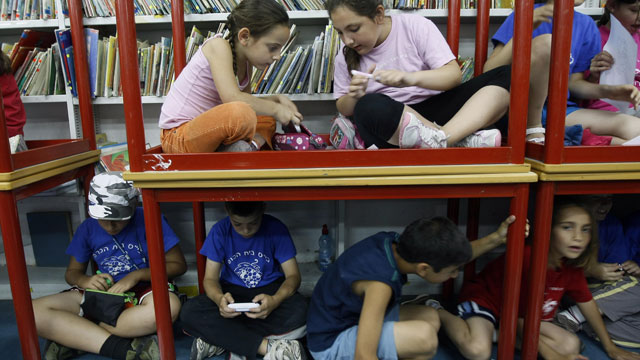 PHOTO: Israeli schoolchildren gather in a bomb shelter at a school in Jerusalem after sirens sounded across Israel as part of a massive civil defence exercise aimed at preparing the country for attacks involving non-conventional weapons on June 2, 2009.