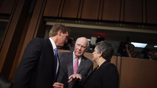 PHOTO: Homeland Security Secretary Janet Napolitano (R) talks with Senate Judiciary Committee Chairman Patrick Leahy (D-VT) (C) and Sen. Jeff Flake (R-AZ) before a hearing of the committee on Capitol Hill April 23, 2013 in Washington, DC.