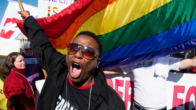 PHOTO: Cd Kirven, of Dallas, Texas, leads chants for marriage equality supporters as they rally in front of the Supreme Court before oral arguments in a case that will test the constitutionality of the Defense of Marriage Act on March 27, 2013.
