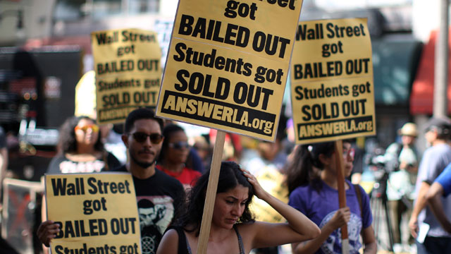 PHOTO: Students protest the rising costs of student loans for higher education on Hollywood Boulevard on September 22, 2012 in the Hollywood section of Los Angeles, California. Citing bank bailouts, the protesters called for student debt cancelations.