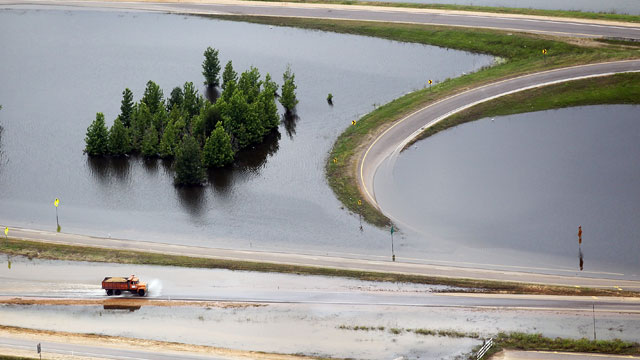 PHOTO:A truck drives along a flooded highway on the Mississippi River on May 23, 2011 in Vicksburg, Mississippi. Floodwaters are beginning to gradually recede in Vicksburg but are likely to remain above flood stage for weeks.